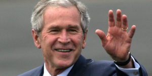 UNITED KINGDOM - JUNE 16:  U.S. President George W. Bush waves upon arrival at RAF Aldgerove in Belfast, Northern Ireland, on Monday, June 16, 2008. Gordon Brown, U.K. prime minister said Britain is pushing the European Union to impose new sanctions against Iran, including freezing the assets of its biggest bank, to pressure the nation to give up its nuclear program at a press conference with Bush in London today.  (Photo by Paul McErlane/Bloomberg via Getty Images)